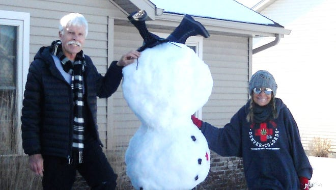 Dennis and Linda Hemauer build snow figures in their yard as a way to enjoy winter.