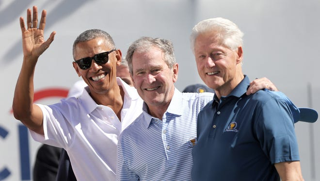 Former presidents Barack Obama, George W. Bush and Bill Clinton are shown in Jersey City before the start of the Presidents Cup on Sept. 28, 2017.