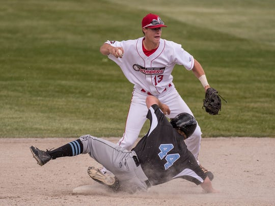 Battle Creek's Tyler Walsh tries to complete a double play during Wednesday's game at C.O. Brown Stadium against Lakeshore.