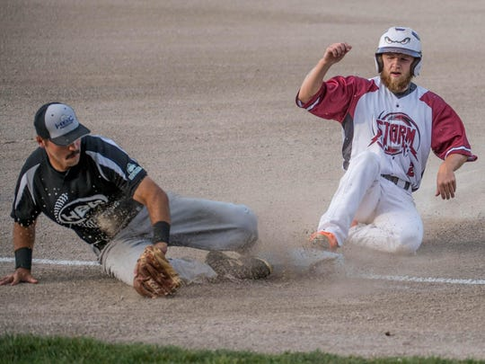 HBC/Behnke third baseman Jimmy Jackson goes for the out during the opening game of the NABF World Series at C.O. Brown Stadium on Wednesday.