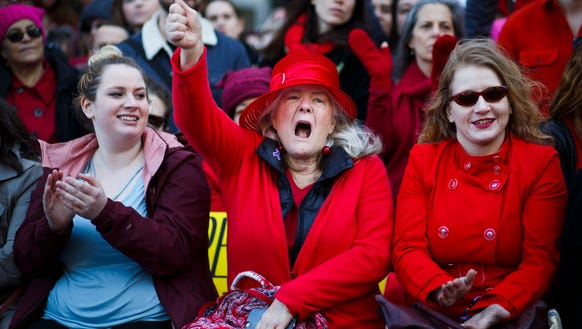 Women gather for a rally and march marking International