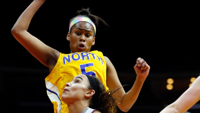 Davenport North's Jinaya Houston (top) signed her National Letter of Intent for the Iowa women's basketball team this week.