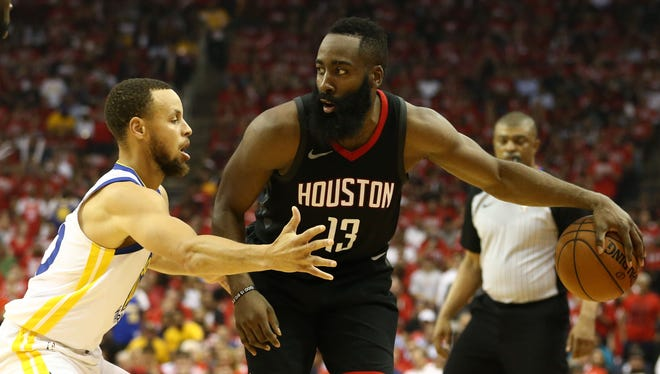 Houston Rockets guard James Harden (13) dribbles against Golden State Warriors guard Stephen Curry (30) during the second quarter in Game 1 of the Western Conference finals.