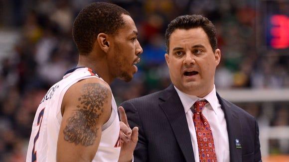 Arizona coach Sean Miller talks with guard Mark Lyons