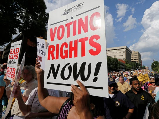 Voting rights activists march through the streets of