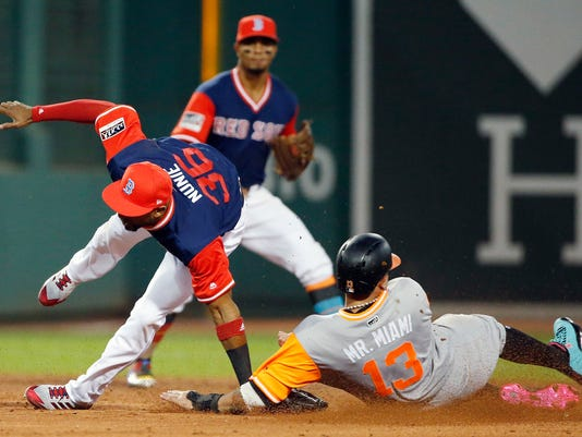 Baltimore Orioles' Manny Machado (13) slides into Boston Red Sox's Eduardo Nunez (36) while stealing second base during the second inning of a baseball game in Boston, Friday, Aug. 25, 2017. Nunez missed the throw on a throwing error and was injured on the play. (AP Photo/Michael Dwyer)