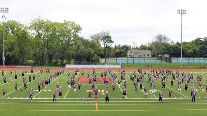 Hilton Central School District teachers, all of whom were honored as Teachers of the Year for 2020, take a socially distanced photo on LeBeau Field at Hilton High School.