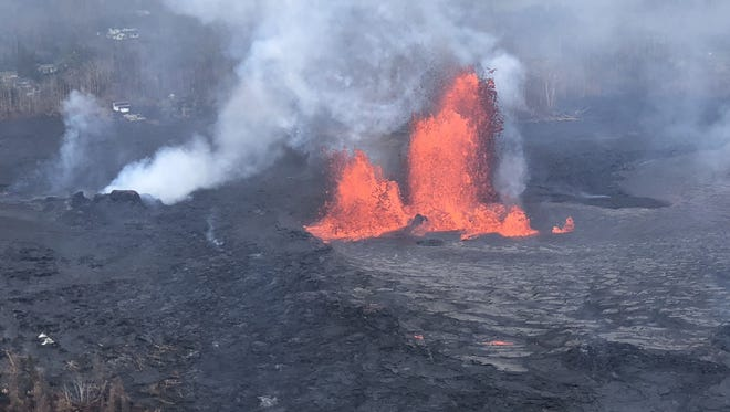 Fast-moving lava flows on Hawaii's Big Island from the Kilauea volcano have blocked one major evacuation route on May 30, 2018.