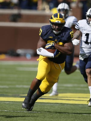 Michigan's Khalid Hill covers the ball as he runs for a first down on a pass reception in the fourth quarter against Brigham Young on Saturday, Sept. 26, 2015, at Michigan Stadium in Ann Arbor, Mich. The host Wolverines won, 31-0. (Julian H. Gonzalez/Detroit Free Press/TNS)