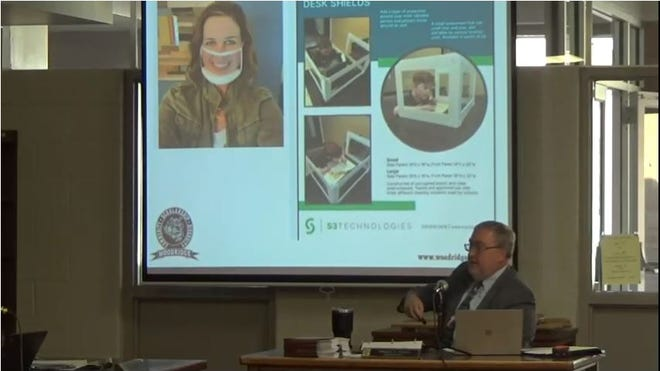 Superintendent Walter Davis talks about the various types of facial coverings, including masks where the mouth is still visible, at the school board's July 21 meeting.