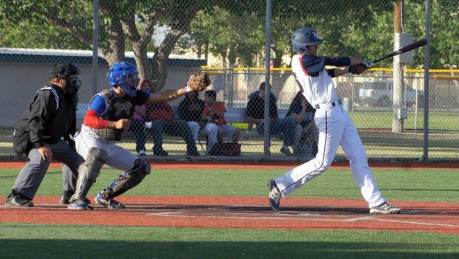 John Wellington took this pitch over the outfield fence in left-center for a two-run home run in Deming's 21-6 loss to the visiting Las Cruces High Bulldawgs Tuesday at Hooten Park.