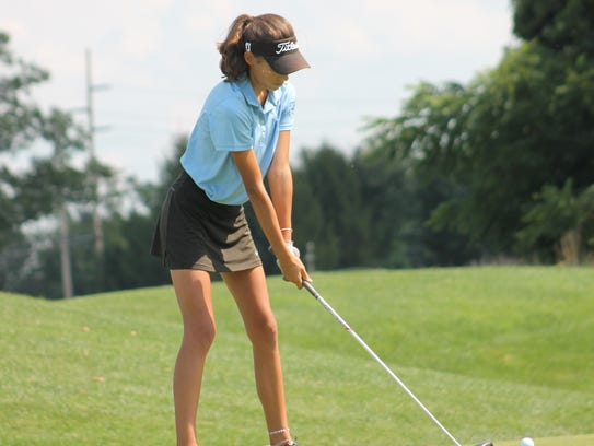 Freshman Leah Swayne prepares to tee off for Kings