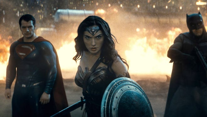 "Scene from 'Batman v Superman: Dawn of Justice.'  Caption: (L-r) HENRY CAVILL as Superman, GAL GADOT as Wonder Woman and BEN AFFLECK as Batman in Warner Bros. Pictures' action adventure ""BATMAN v SUPERMAN: DAWN OF JUSTICE,"" a Warner Bros. Pictures release."
