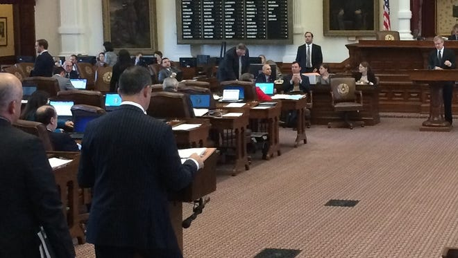 Democratic state Reps. Eric Johnson (left), Chris Turner and Rafael Anchia question voter ID bill sponsor Phil King in the Texas House on May 23, 2017.
