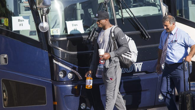 Arizona Cardinals running back Adrian Peterson prepares to board a bus before a flight to London at their training facility in Tempe, Ariz. October 16, 2017. They will play the Los Angeles Rams at Twickenham Stadium on October 22.