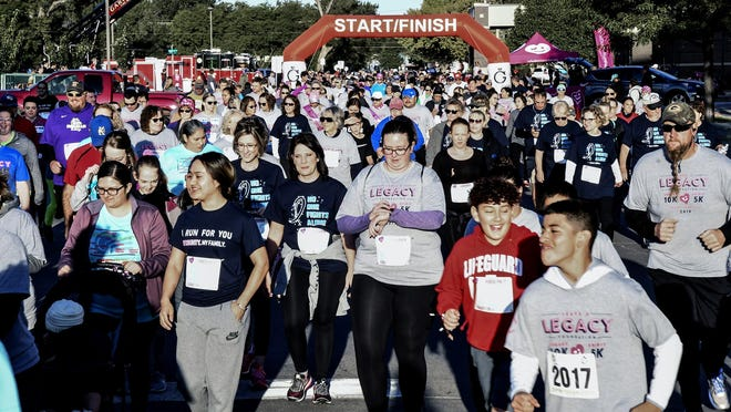 A mass of runners and walkers make their way east of Spruce Street from the Heartland Cancer Center to Fourth Street to start the 2019 Leave a Legacy 5K and 10K races. The year drew a record number of participants, 1091. With the COVID-19 pandemic, this year's event will be going to a virtual format.