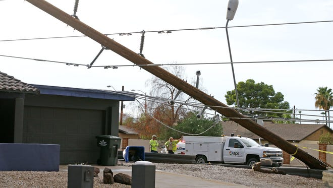 Downed power lines cover a home at Shea Boulevard and 40th Place on Aug. 3, 2017, in Phoenix.