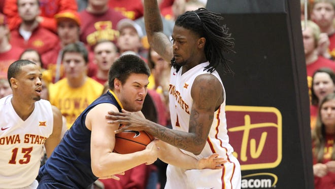 Iowa State's Jameel McKay (1) defends West Virginia Mountaineers forward Nathan Adrian (11) at Hilton Coliseum. The Cyclones beat the Mountaineers 79-59. Mandatory Credit: Reese Strickland-USA TODAY Sports