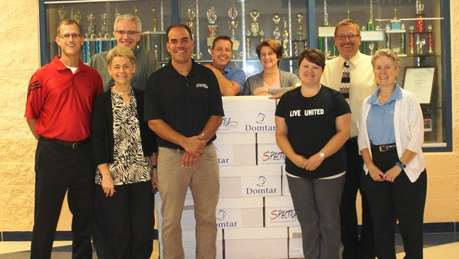 Domtar's Nekoosa Mill and Spectra Print Corp. of Stevens Point presented a pallet of loose-leaf paper to the Nekoosa School District on Sept. 3. The presentation took place at Alexander Middle School in Nekoosa. This is part of collaborative effort between Domtar and Spectra Print to donate paper through the Stuff the Bus program. Pictured are (at back) Matt Fischer, General Manager of Domtar's Nekoosa Mill; from left, Craig Timm, Government Relations Manager (Domtar); Brian Lang, Wood Yard & Railroad Supervisor, Domtar; Joanne Keyzer, Training Coordinator, Domtar; Terry Whitmore,  Nekoosa School District Superintendent; (at front) Ginny Johnson, Business Relations Coordinator, Domtar; Hans Hofmeister, Executive Vice President, Spectra Print Corp.; Amy Fluno, United Way of Inner Wisconsin Program Director; and Susan Molinarolo, Quality and Technical Manager, Domtar.