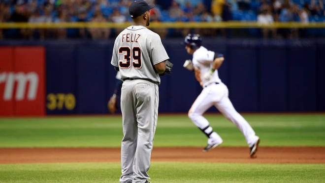 Detroit Tigers relief pitcher Neftali Feliz (39) looks on as Tampa Bay Rays third baseman Evan Longoria (3) runs the bases after hitting a solo home run during the eighth inning at Tropicana Field.