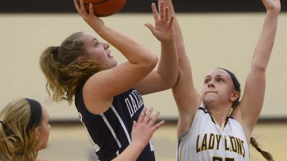 Dallastown's Sabrina Stough goes up for a shot while being guarded by Red Lion's Courtney Dimoff, right, and Hannah Wolf on Dec. 8. Red Lion beat Dallastown 52-32.