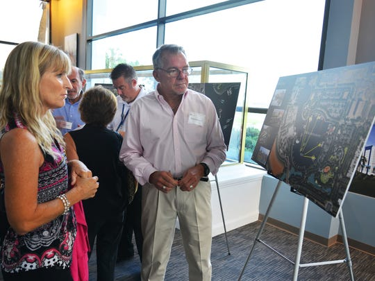 Randy Hollingworth of Bermello Ajamil & Partners talks about Port Canaveral's Cove area with Cindy Hadaller of the Port Canaveral Yacht Club after the presentation.