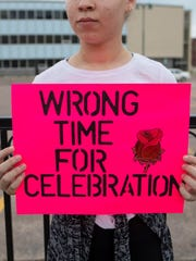 Treya Theus, 13, participates in a protest in downtown