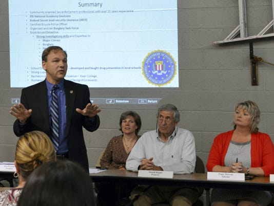 With a summary of his qualifications displayed behind him, Cleona's new police chief Jeffrey Farneski fields questions Monday at Borough Council's meeting. Barbara West-Lebanon Daily News