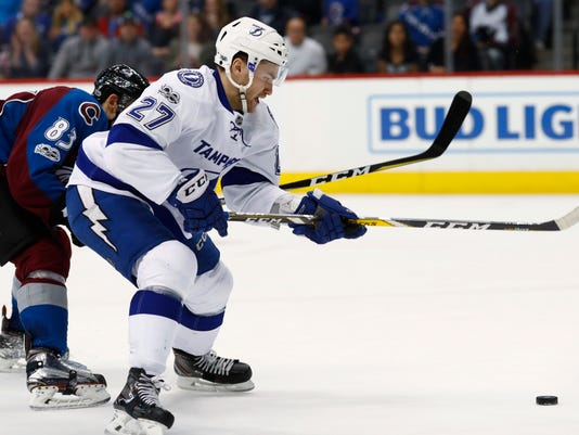 Tampa Bay Lightning left wing Jonathan Drouin, front, drives past Colorado Avalanche left wing Matt Nieto to score the winning goal in overtime of an NHL hockey game, Sunday, Feb. 19, 2017, in Denver. Tampa Bay won 3-2. (AP Photo/David Zalubowski)