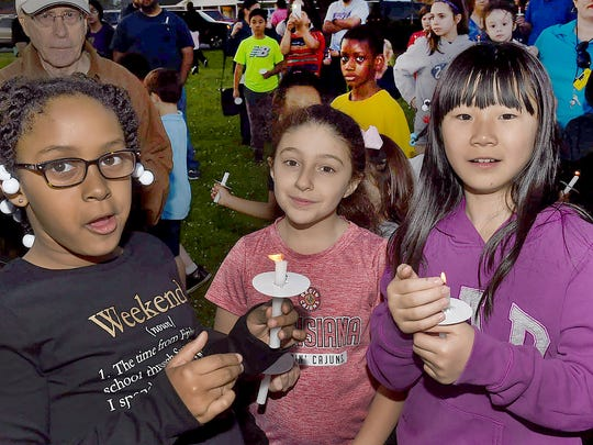 Park Vista Elementary students attend a candlelight vigil in opposition of the school board property tax to be voted on March 24.