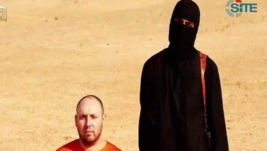 This screen grab from a video posted by a the Islamic State terrorist group purportedly shows American freelance journalist Steven Sotloff, 31, moments before he is killed. The video was provided by SITE, a U.S. intelligence monitoring group.