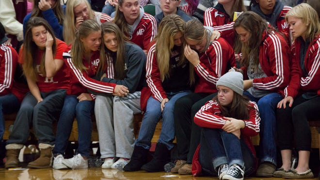 Members of the community and students grieve during a gathering at Marysville-Pilchuck High School Sunday in Marysville, Washington.