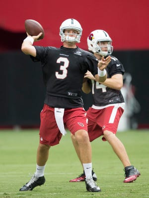 Cardinals starting quarterback Carson Palmer throws during Saturday's first training camp session at University of Phoenix Stadium.