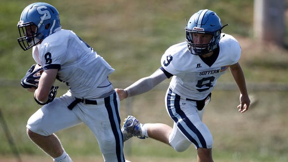 Suffern's Lucas Sommers takes a handoff from Zack Mabry