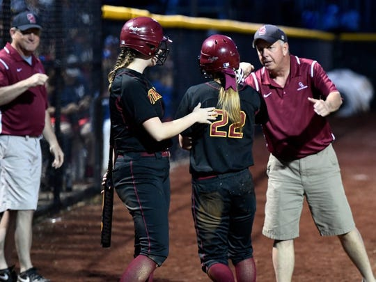 MIKE LAWRENCE / COURIER & PRESS Gibson Southern coach Gary May congratulates Lora Barton after she scored in the fourth inning of the sectional championship against Castle at North High School Thursday night, May 26, 2016.