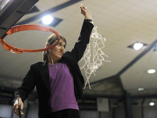 Abilene Christian head coach Julie Goodenough holds