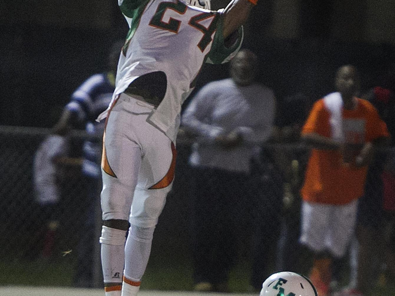 Dunbar receiver Lemarcus Young goes up for a reception above Fort Myers defender Jarrett Bassett at Sam Sirianni Field in Fort Myers Friday.