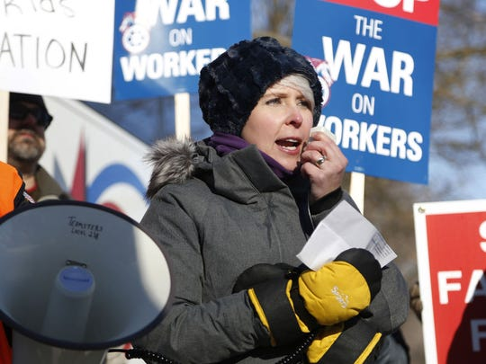 Former Iowa Senate communications director Kirsten Anderson speaks to the crowd outside Iowa State Sen. Majority Leader Bill Dix's home during a protest Saturday in Shell Rock.