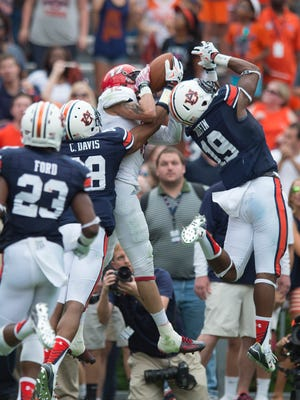 Auburn Tigers defensive back Carlton Davis (18) and Auburn Tigers defensive back Nick Ruffin (19) push Jacksonville State Gamecocks wide receiver Josh Barge (12) out of bounds in the end zone on fourth down during overtime of the NCAA Auburn vs. Jacksonville State on Saturday, Sept. 12, 2015, in at Jordan-Hare Stadium in Auburn, Ala.Albert Cesare / Advertiser