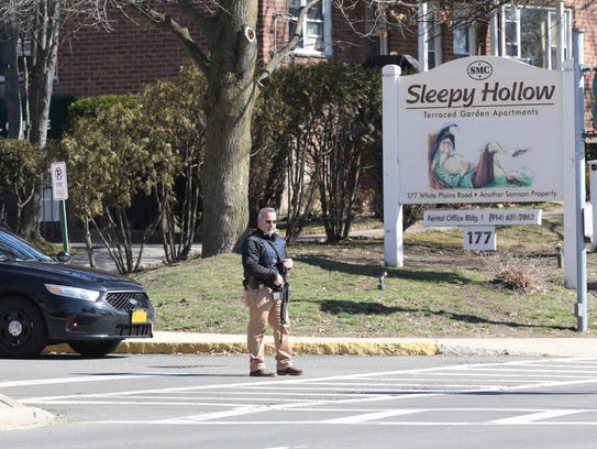 A police officer stands guard outside a Sleepy Hollow
