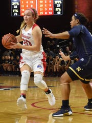 Marist College's Hannah Hand sets to pass against a Navy defender during the 2017-18  season-opener. She missed all of 2018-19.
