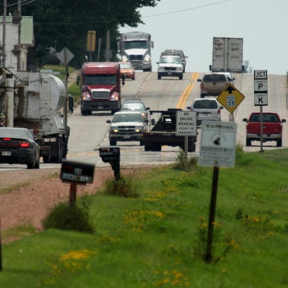 Two crew-cab pick-ups enter the tiny village of Unity, in central Wisconsin, Tuesday, July 28, 2015. Unity is one of many municiplities in the state that have missed out on the maximum amount of funding it could have had for its roads.