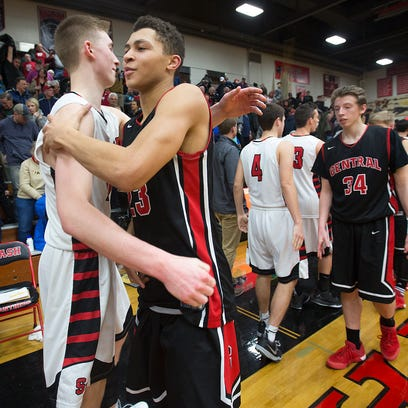 SPASH's Sam Hauser, left, greets La Crosse Central's Kobe King after SPASH defeated La Crosse Central 84-56 in a non-conference basketball game at Stevens Point Area Senior High School, Tuesday, Feb. 9, 2016.