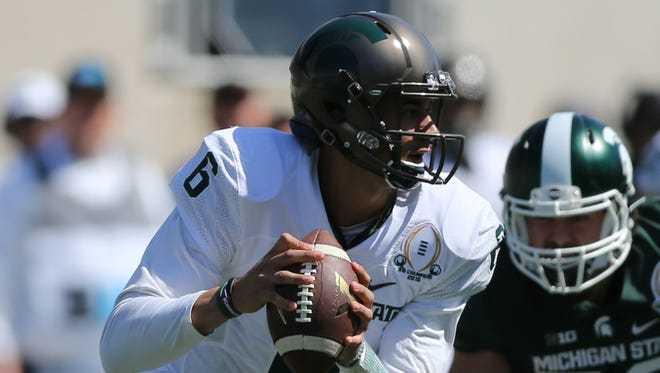 Michigan State quarterback Damion Terry runs the offense during the Green and White game Saturday in East Lansing.