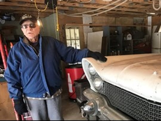 Bob Lucas, 93, stands next to the 1960 Lincoln convertible