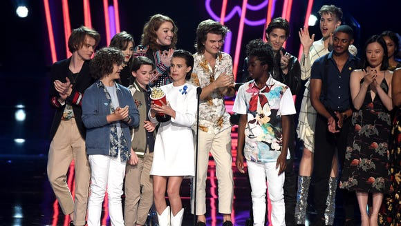 The cast of 'Stranger Things' win for best show, accepting