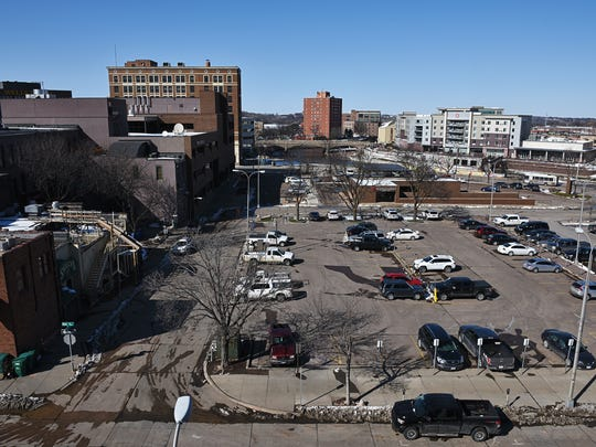 City Hall could sell or redevelop any of its eight surface parking lots downtown, a plan called for in its 2025 Downtown Plan.