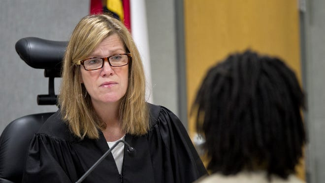 In this March 28, 2014 photo, Judge Julie Kocurek presides over her court in Austin.  Police are searching for suspects after Kocurek was shot and wounded in the driveway of her Austin home on Friday, Nov. 6, 2015. She remained hospitalized Saturday with injuries that aren't believed to be life-threatening.   (Laura Skelding/Austin American-Statesman via AP)  AUSTIN CHRONICLE OUT, COMMUNITY IMPACT OUT, INTERNET AND TV MUST CREDIT PHOTOGRAPHER AND STATESMAN.COM, MAGS OUT; MANDATORY CREDIT