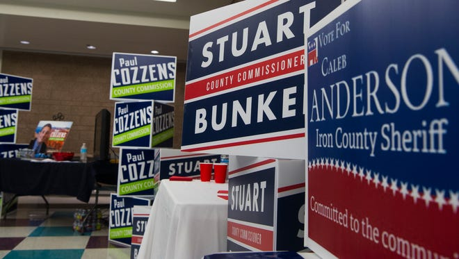 Campaign signs line the halls during the Iron County Republican County Convention at Canyon View High School Saturday, April 14, 2018.