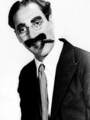 Groucho Marx, shown in this 1933 handout photo, died